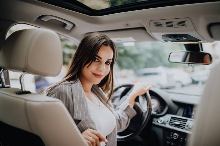 pretty girl driving BMW